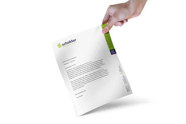 Briefpapier in huisstijl van Schokker Producties.